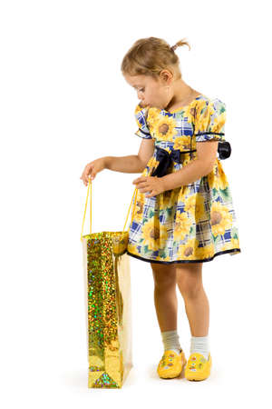 Little girl with shopping bag. Isolate on white background. photo