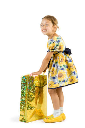 youngs: Little girl with shopping bag. Isolate on white background.