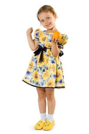 Little girl with orange. Isolate on white background. Stock Photo - 1585064