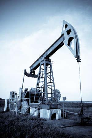 derrick: Oil pump jack. Selenium tone. Stock Photo