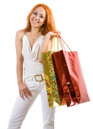 Young girl with shopping bags. Isolate on white background. photo