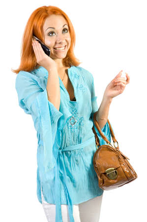 Young girl with bags and mobile phone. Isolate on white background. photo