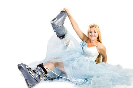 Beautiful bride. Pretty women in wedding dress and ski boots.