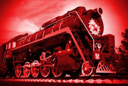 Steam locomotive standing like monument photo