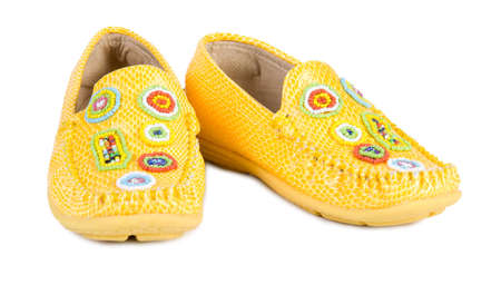 moccasin: Yellow shoes. Isolate on white.