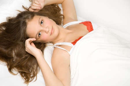 Young caucasian girl in bed photo
