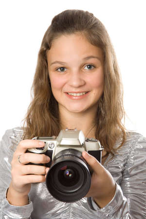 Young girl with SLR camera. Isolate oin white. photo