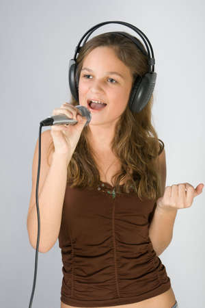 recordings: Young pretty girl singing.