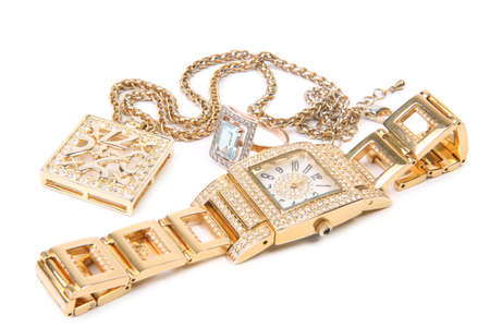 Jewelry set. Golden watch, ring and necklace. Stock Photo