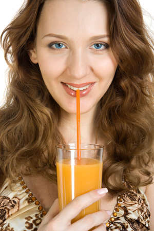 Attractive brunette drink orange juice. Isolate on white. photo