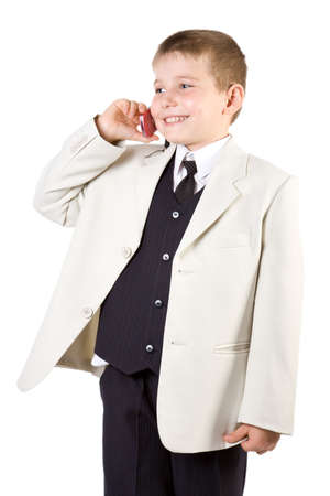Well-dressed boy like businessman calling at mobile phone isolated on white Stock Photo - 2474758