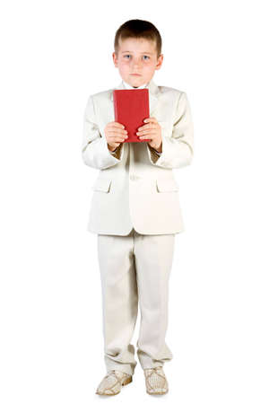 Well-dressed boy hold red book. Isolated on white Stock Photo - 2474685