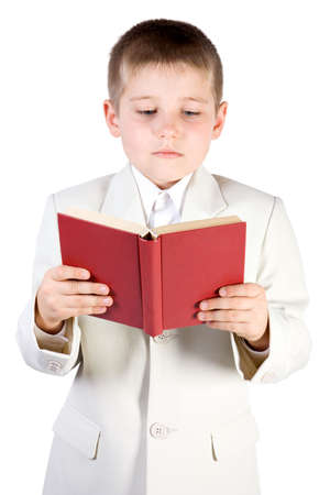 learned: Well-dressed boy read red book. Isolated on white