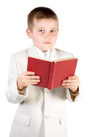 Well-dressed boy read red book and looking in camera. Isolated on white Stock Photo - 2474737