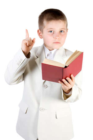 Well-dressed boy read book and lift finger up. Isolated on white Stock Photo - 2474674