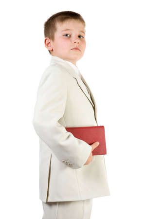 educating: Well-dressed pride boy hold red book. Isolated on white