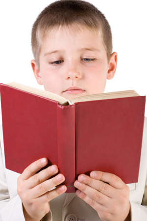Well-dressed boy read red book. Close-up. Isolated on white Stock Photo - 2474766