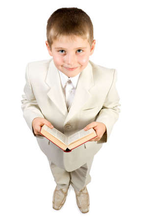 learned: Well-dressed smiling boy hold red book and look up. Close-up. Isolated on white Stock Photo