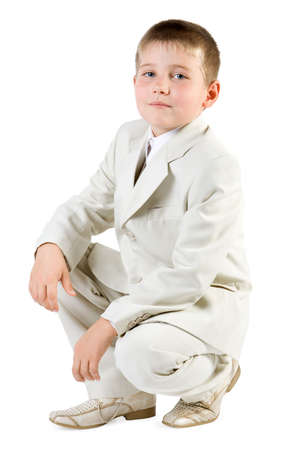 Well-dressed serious boy like businessman. Isolate on white Stock Photo - 2474742