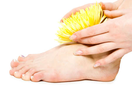 Woman foot and hand with yellow flowers isolate on white Stock Photo - 2474732