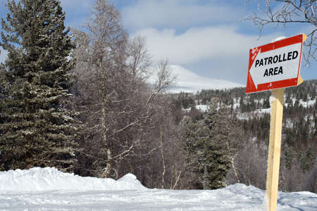 Sign patrolled area on mountain slope for ski and snowboarding freeride  photo