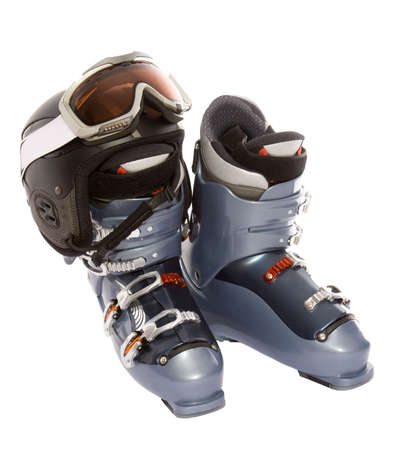 Ski boots helmet and goggles. Isolate on white