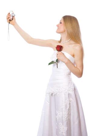 Young happy bride make self-portrait by portable digital camera photo