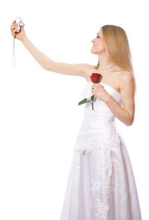 Young happy bride make self-portrait by portable digital camera photo