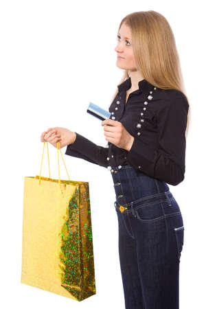 Happy young girl with credit card and shopping bag isolate on white photo