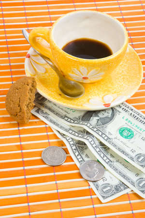 pay for: Three dollars and 50 cent pay for coffee and cookies on bamboo table-cloth