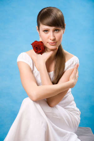 Attractive brunette with red rose isolated on blue Stock Photo - 2861311