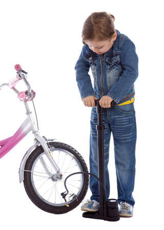 to inflate: Young girl inflate wheel her bike isolated on white Stock Photo