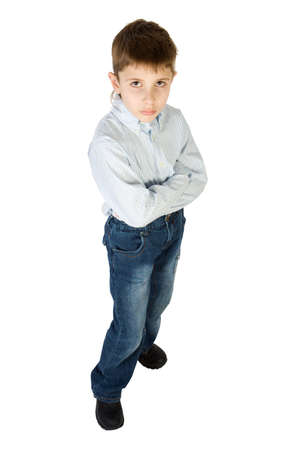 Surious boy stand and look up isolated on white Stock Photo - 3057651