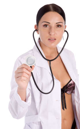 Pretty female doctor holding stethoscope isolated on white background Stock Photo - 3092973
