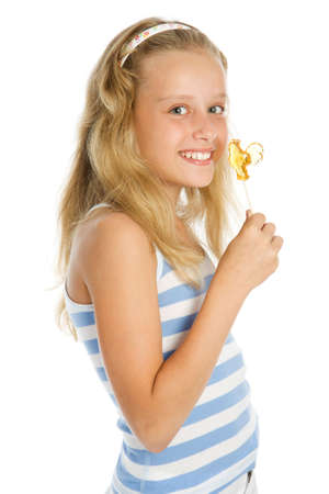 Beautiful young smiling girl with lollipop candy photo