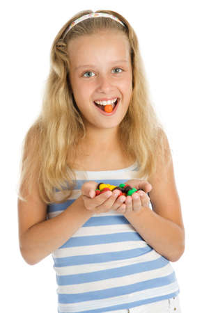 Beautiful young smiling girl with chocolate candy photo