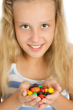 Beautiful young smiling girl with chocolate candy Stock Photo