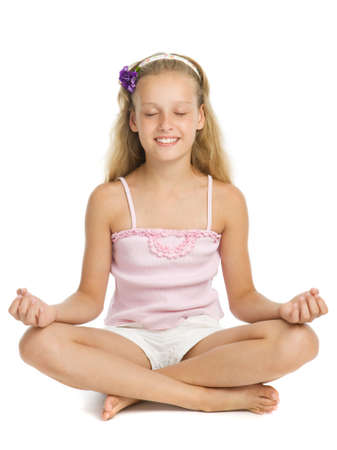 Young pretty girl relaxes with her eyes closed in a yoga pose Stock Photo