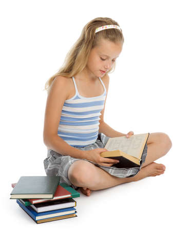 Pretty teenager girl sit on floor and reading book  photo