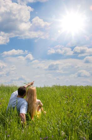 Attractive couple together on meadow in sunny day