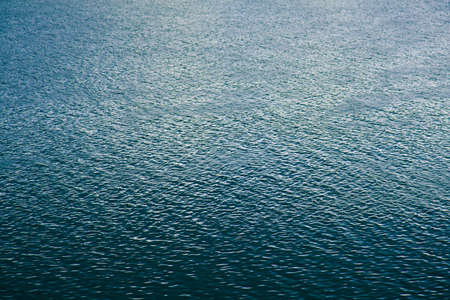 Texture of ripple on blue water river surface