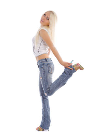 knee bend: Attractive girl stay and bend leg in the knee Stock Photo