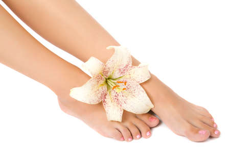 Woman foot with lily flower isolate on white Stock Photo - 3500646