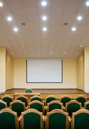 Modern auditorium hall for presentation with projection screen