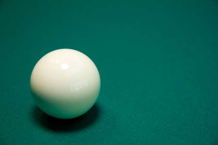 poolball: White billiard ball on a green table