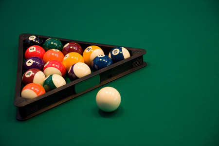 poolball: Color billiard balls on a green table in sport bar  Stock Photo