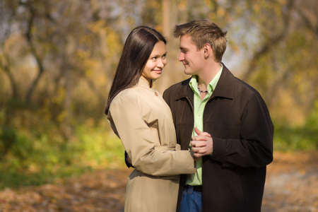 Young couple in love meeting in the autumn park