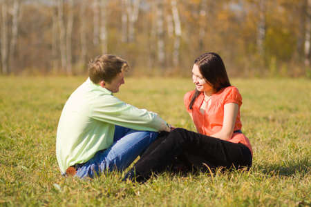 Young couple together on meadow in summer day photo