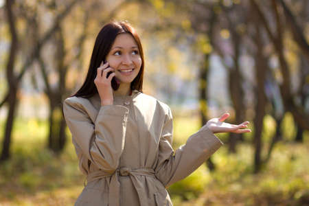 Pretty brunette caucasian girl on cellphone photo