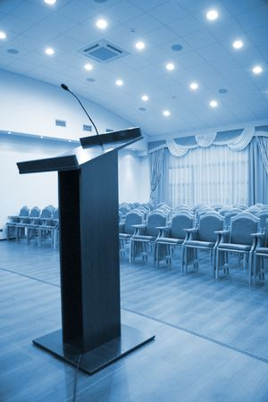 Modern auditorium hall for presentation with tribune